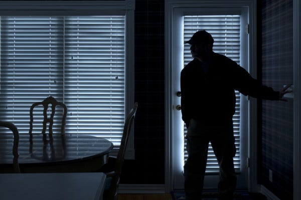 Picture of Burglar Entering House