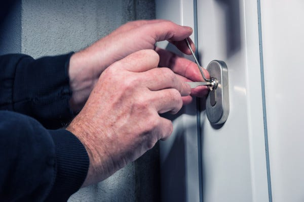 Picture of person picking lock