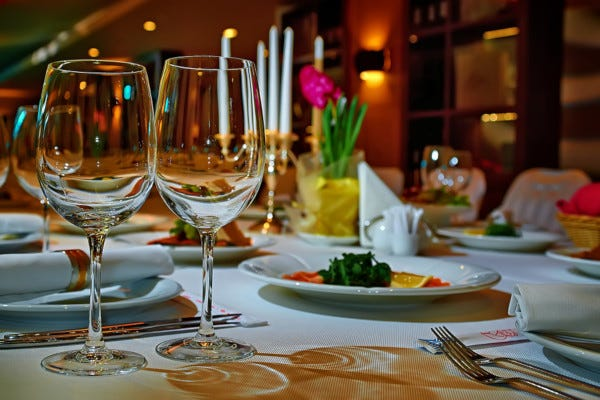Picture of dining room table set for dinner