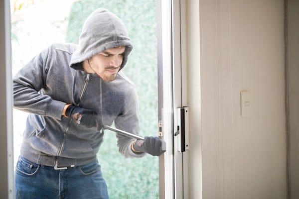 Picture of burglar entering through the front door