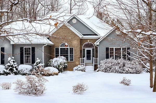 Picture of House Covered in Snow