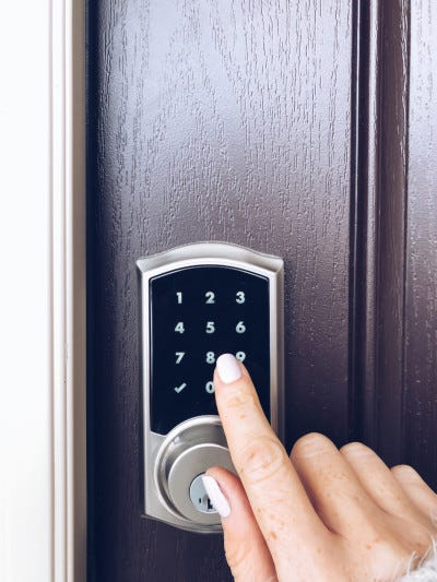 Picture of person using a smart door lock