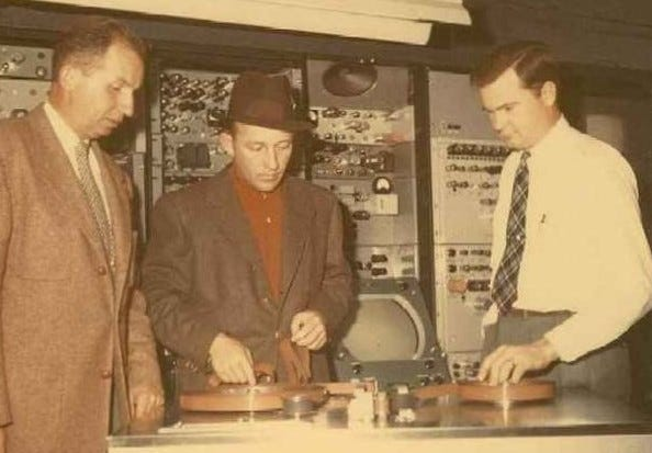 Picture of Men Developing Videotape Recording