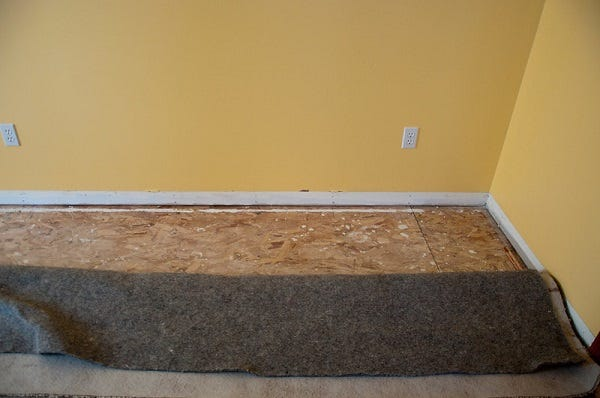 Picture of removing baseboards and carpet