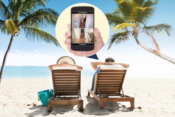 Person viewing home security camera video while on vacation