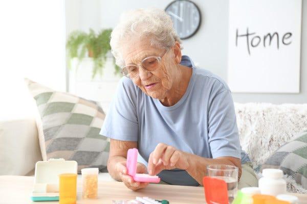 Picture of Senior Taking Medicine